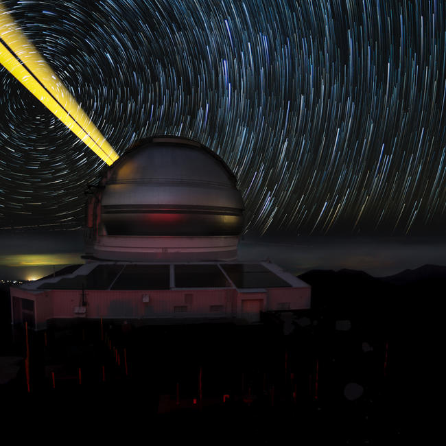 Gemini North telescope propagates yellow laser guide star trails in time-lapse image
